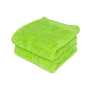 A green microfiber towel is displayed with a blank background