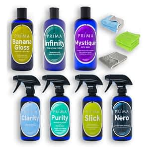 Seven bottles of Prima Car Care products are displayed with a blank background with three microfiber towels