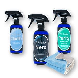 Three bottles of Prima Car Care products are displayed with a blank background with a microfiber towel